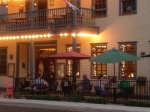 Smokey Barq  with a crowd of patrons in the outdoor seating on  balmy September evening.