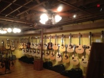 """Pricey guitars on display in the """"for serious buyers only"""" room."""