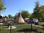 A full size tee pee engulfs the Green