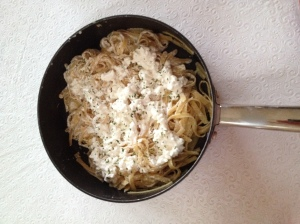 Fettucini, fried in butter  with sour cream folded in, topped with cottage cheese, and garnished with parsley.