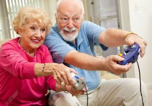 5063130-Senior-couple-having-fun-playing-video-games--Stock-Photo-elderly