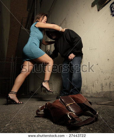 stock-photo-woman-beating-up-the-assailant-27443722.jpg