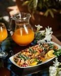 vegetable-stew-garnished-with-herbs-lemon-served-with-orange-juice_140725-2595